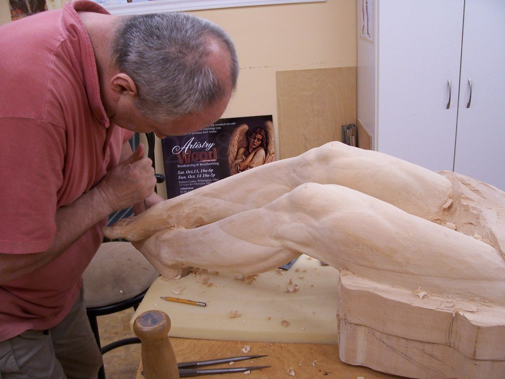 Frederic carving Jesus legs