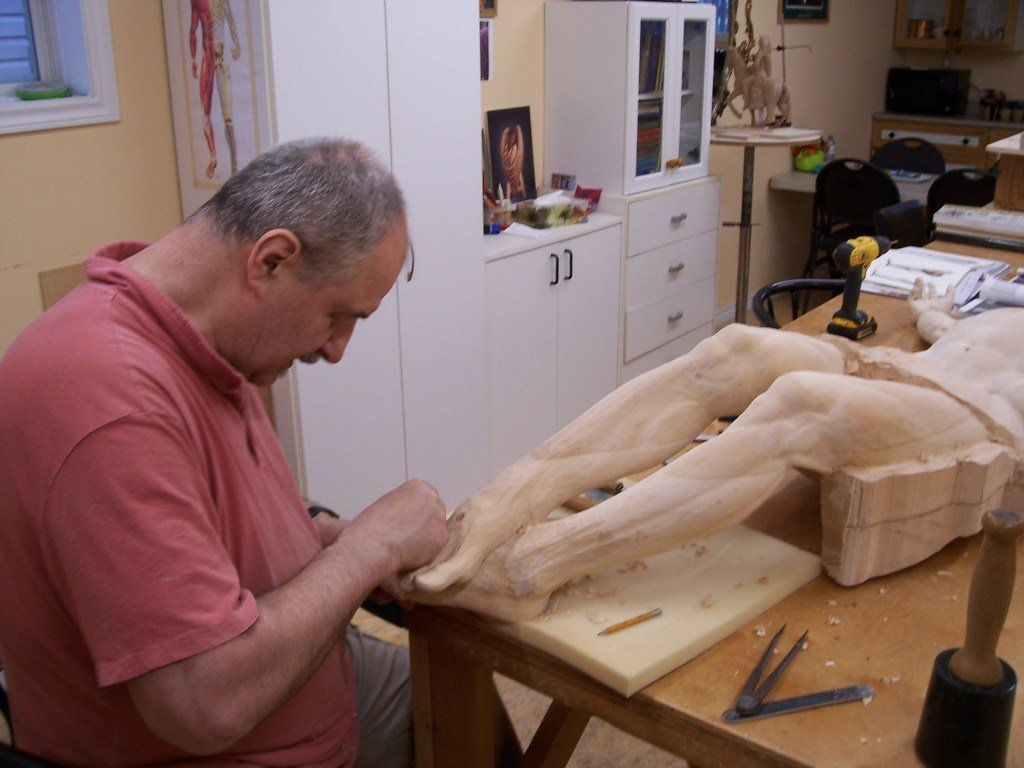 Frederic carving Jesus feet