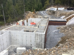 Mar 13 - Shoring for suspended slab above lower. All exterior tie holes grouted for waterproofing