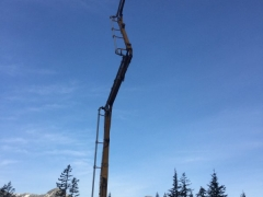 Mar 7 - Concrete pump setting up for upper basement wall pour with the corridor mountains as a back drop